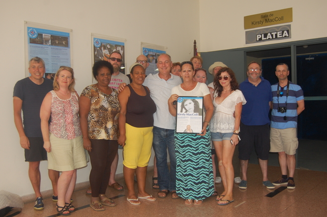 Miramar Theatre staff are presented with a new display plaque on Kirsty MacColl by participants on the 2017 Cycle Cuba Challenge