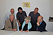 Music Fund trustees, Ken Gill, Mike Seifert, Nick Gold, Jean MacColl, Michael Chambers, and Director Rob Miller sign the terms of reference for the Miramar Theatre project.