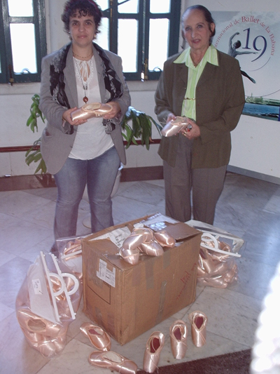 Director  of the Cban National Ballet School, Ramona de Sáa Bello, receives the first shipment of shoes donated by the Royal Ballet
